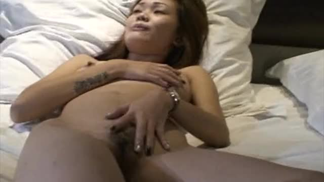 In a hotel bed, Mia the gogo bar girl is waiting for some cock